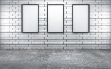 room with three blank frames on white wall. 3d rendering