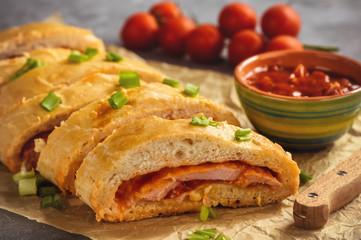 Ham and cheese stromboli, italian cuisine.