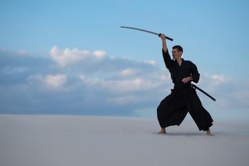 Garden Poster Martial arts Concentrated man with a Japanese sword - a katana
