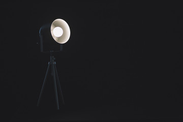 Lamp on tripod in studio