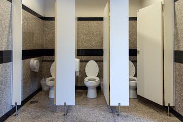 Flush toilet in Public three rooms toilet and open door