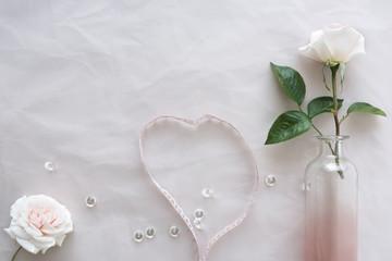White wedding roses on tender background