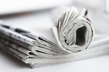Folded and rolled newspapers. Daily papers with news. Stack of tabloid journals and magazines, pile of business press. Periodic publications with headlines and articles, side view
