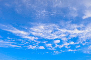 Clouds on a sunny blue sky. Heavenly background. Universal template for background insertion.