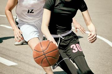 Women play basketball.