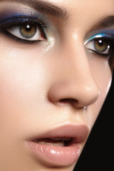 Closeup with of beautiful woman. Fashion makeup, clean shiny skin with highlighter. Makeup and cosmetic. Beauty style