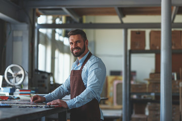 Smiling man in workshop