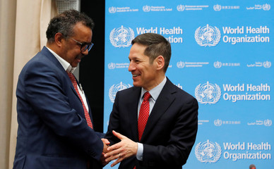 Director-General of the WHO Tedros arrives with Frieden, President and CEO Resolve to Save Lives for a news conference in Geneva