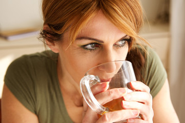 Mature woman drinking a cup of tea