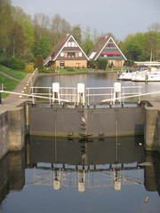 Canalside houses and closed lock gates