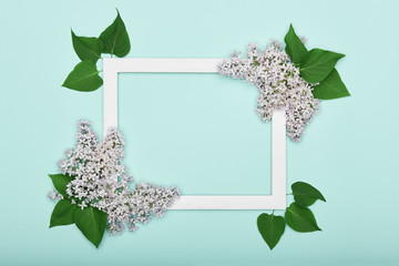 Happy Mother's Day, Father's day, Women's Day or Birthday Pastel Candy Blue Colour Background. Floral flat lay minimalism greeting card with picture frame mock up.