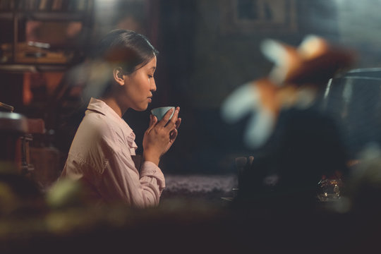 Young asian girl at a tea ceremony