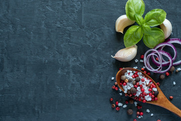 Basil Garlic and spices on stone table. The concept of cooking. Top view with space for text