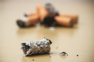 closeup of butts of cigarettes - Concept stop cigarette on wooden table background