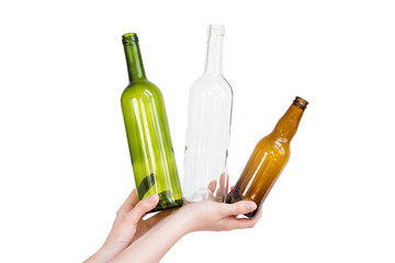 Female hand holding different types of glass bottles isolated on white. Recyclable waste. Recycling, reuse, garbage disposal, resources, environment and ecology concept