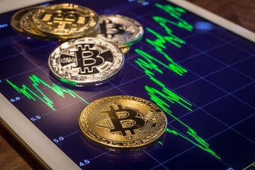Cryptocurrency bitcoins with increase market price graph.