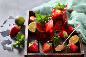 Strawberry lemonade drink, refreshing summer sangria with strawberries, lime and mint