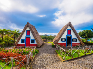 Traditional folk village with artistic cottage houses in Santana region of Madeira, Island of Portugal