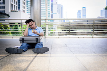 Adisn business man sitting in depression with bit coin money.