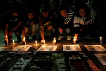 Football supporters from East Java hold a vigil for victims of the suicide bomb attacks in Surabaya at a city park in Jakarta