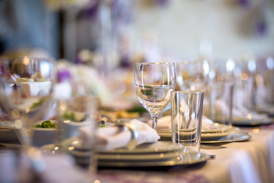 Beautiful table setting with crockery and flowers for a party, wedding reception or other festive event.