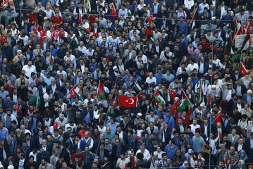 Pro-Islamist demonstrators march during a protest in support of Palestinians and against the U.S. moving its embassy to Jerusalem, in Istanbul
