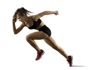 Woman sprinter leaving starting on the athletic track