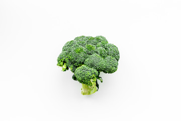 Fresh uncooked broccoli on white background top view copy space
