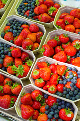 Strawberries and blueberries on the market