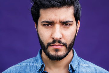Portrait of eastern arabian man on purple background