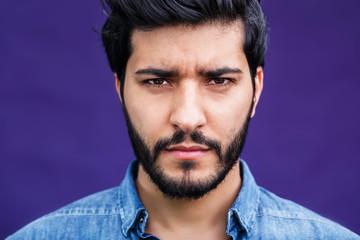 Portrait of eastern arabian man on purple background