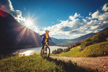 woman on e-bike enjoying view to a beautiful lake