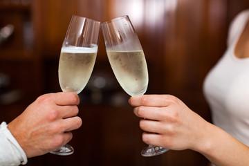 Couple toasting glasses of champagne