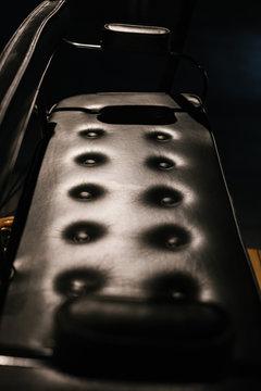 Black chair in retro car closeup