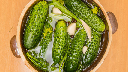 Making pickled cucumbers in clay jar