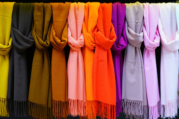 Colorful hanging display of wool scarves  Wall mural