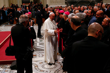Pope Francis is greeted at the end of a meeting with faithful of the diocese of Rome at Saint John Lateran Basilica in Rome
