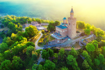 Aerial sunrise view of Tsarevets Fortress in Veliko Tarnovo in a beautiful summer day, Bulgaria 2018