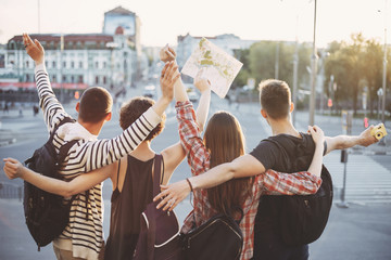 Friends traveling together. Cheerful students rising hands. People, sightseeing, vacation, holidays adventure friendship togetherness