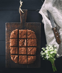 baked rectangular chocolate brownie pie is cut into squares