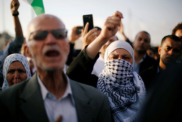 A woman gestures as she takes part in a sit-in near the U.S. Embassy in Amman