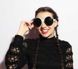 Fashion concept. Beauty surprised fashion model girl wearing big sunglasses.