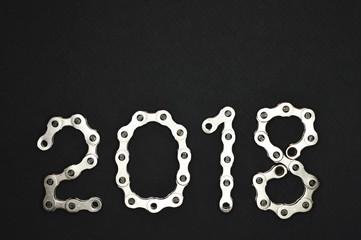 bike chain year 2018 lower section on dark background