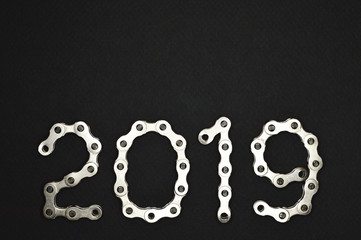 bike chain year 2019 lower section on dark background