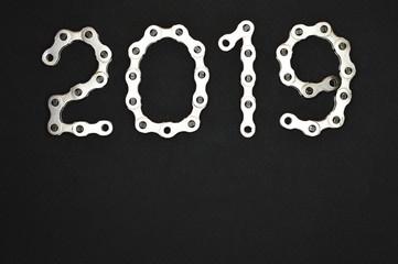bike chain year 2019 upper section on dark background