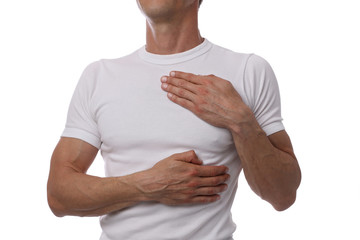 Man having a pain in the heart area. Heart health, High Blood Pressure prevention concept