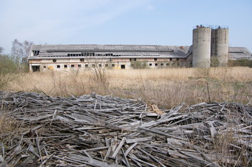 Abandoned farm with ruins of wooden building