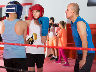 Young boys at boxing training with instructor