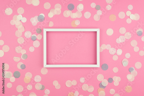 White picture frame and confetti on pink background top view flat white picture frame and confetti on pink background top view flat lay mockup stopboris Image collections