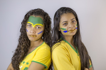 Girls fans of Brazil team sadly with the game result